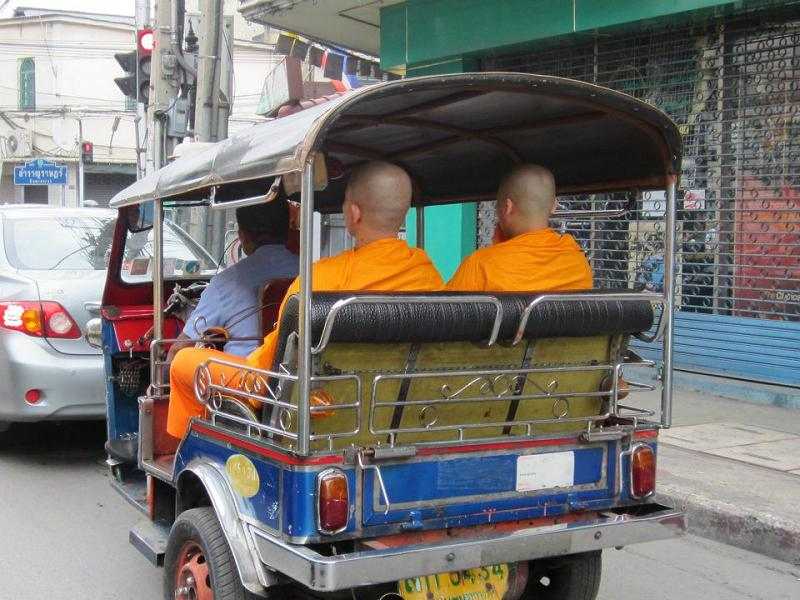 Monks riding a Tuk Tuk in Thailand