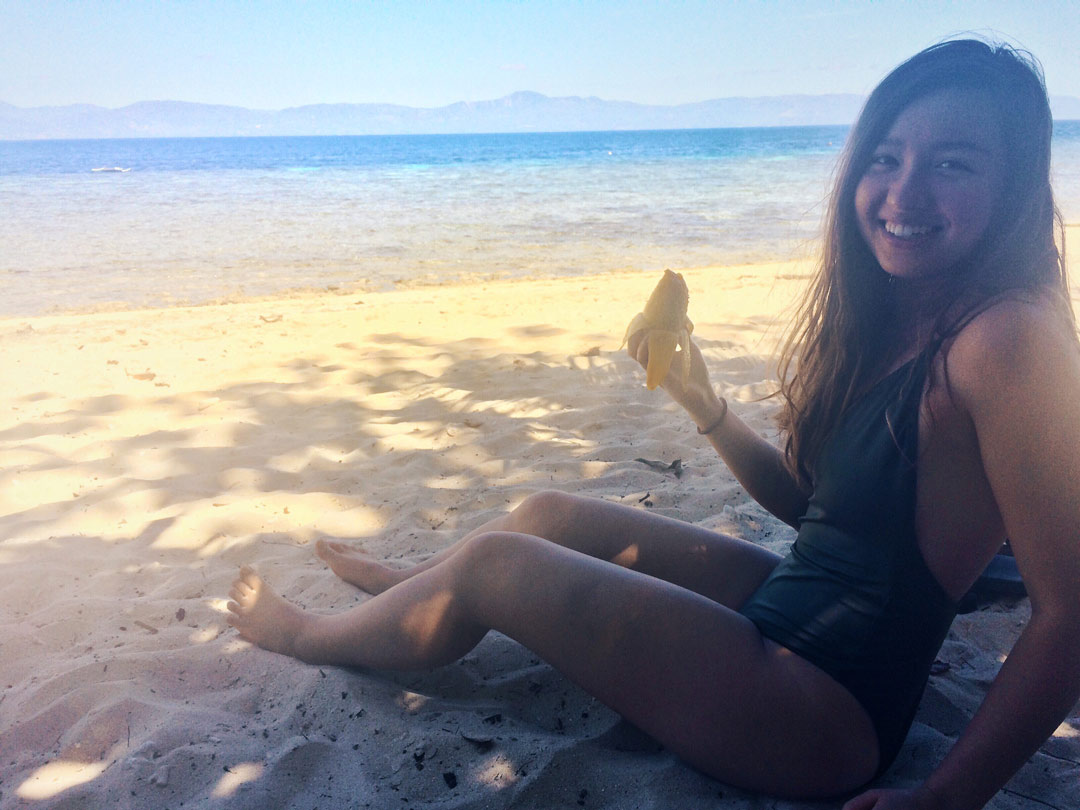 Eating mango on the beach