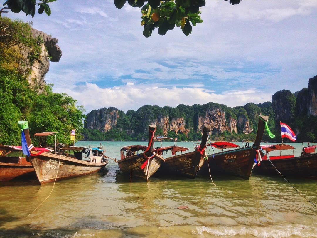 Krabi's most famous beach is called Railay, and it's known for its beautiful longtail boats that you can take to go island hopping.
