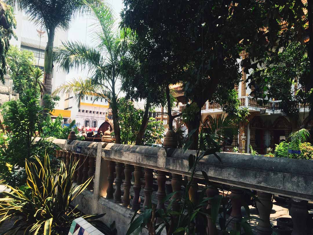 The city is a unique blend of lush greenery, old moat ruins, historic temples, and hopping cafes and massage schools.
