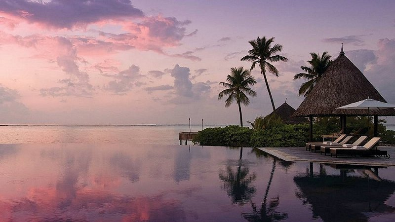 Infinity pool at the Four Seasons Resort at Kuda Huraa, Maldives.