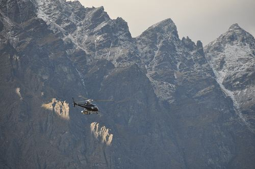 Helicopter against the backdrop of the Remarkables, near Queenstown