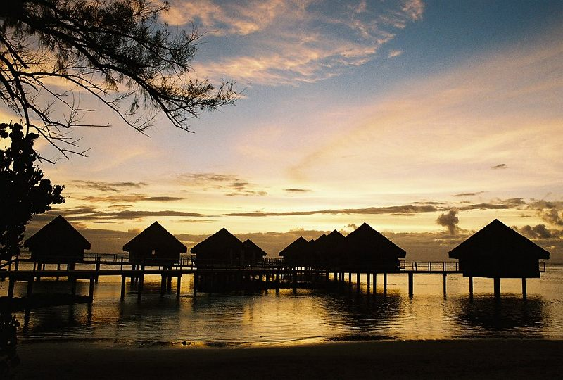 Overwater bungalows at sunset, Le Meridien, on Tahiti Nui