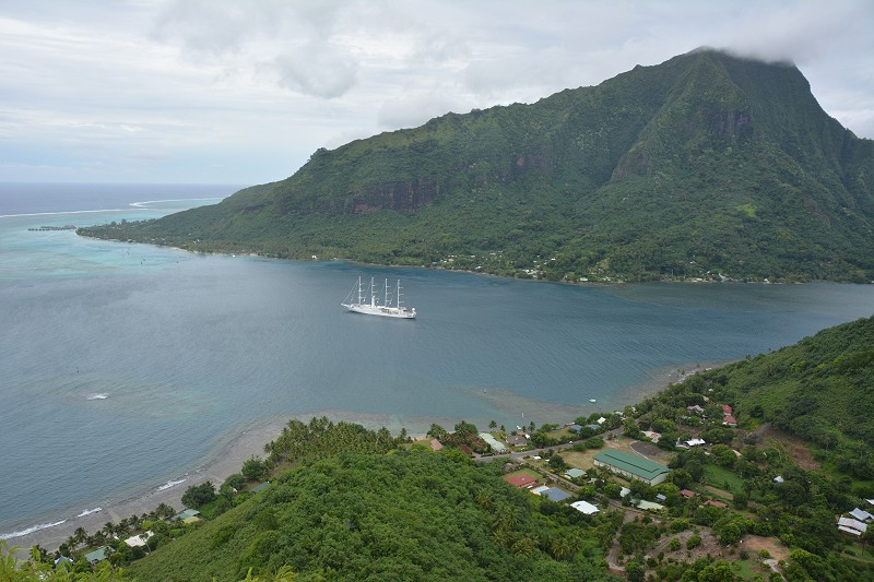 Mountains, lagoon, and sailing ship on the island of Moorea