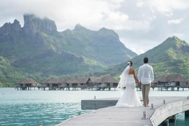Mount Otemanu, Bora Bora, French Polynesia is one of the most iconic backdrops in the world for your wedding photos.  Photo courtesy Four Seasons Resort Bora Bora.
