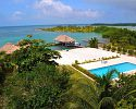 Swimming Pool and St. George's Caye - St. George's Caye Resort